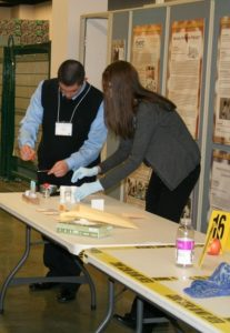 Dr. Brittany Baguley demonstrates forensic analysis techniques during a mini lab demonstration