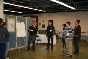 At SCIP, students gather around Andy Stevenson, a Special Projects Associate at Tesla Motors