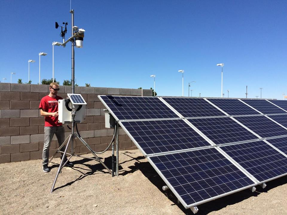 A scientist working with solar panels