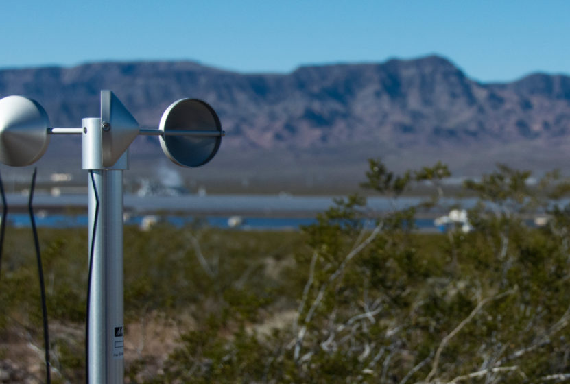 An instrument for remote monitoring and data collection in the foreground of the desert landscape