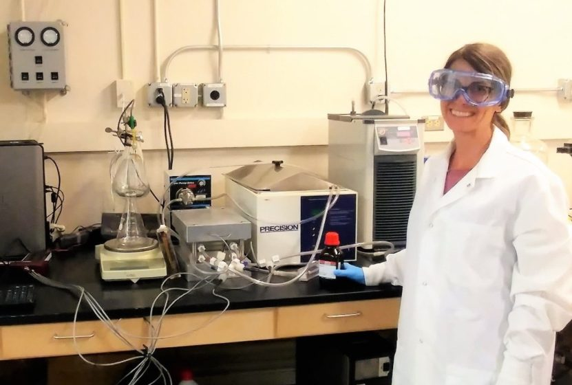 Coral Taylor, University of Nevada, Reno Graduate Student poses with the Bench-Scale Membrane Distillation System