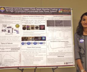 Undergraduate Cilla Jose poses with her winning poster