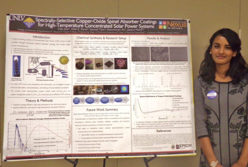 Undergraduate Cilla Jose poses with her winning poster