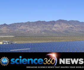 A large field of Solar panels, desert mountains in the background