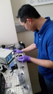Undergraduate student researcher Samuel Tam prepares samples for spectral absorptivity measurements