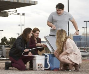 Erica Marti works with UNLV students to assemble a portable solar energy classroom kit